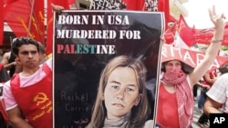 Lebanese anti-American protesters display a poster of peace activist Rachel Corrie during a demonstration near the U.S. Embassy in Aukar northeast of Beirut, Lebanon, June 6, 2010.