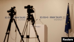Video cameras set for start of news conference, Vienna International Center, May 14, 2014.