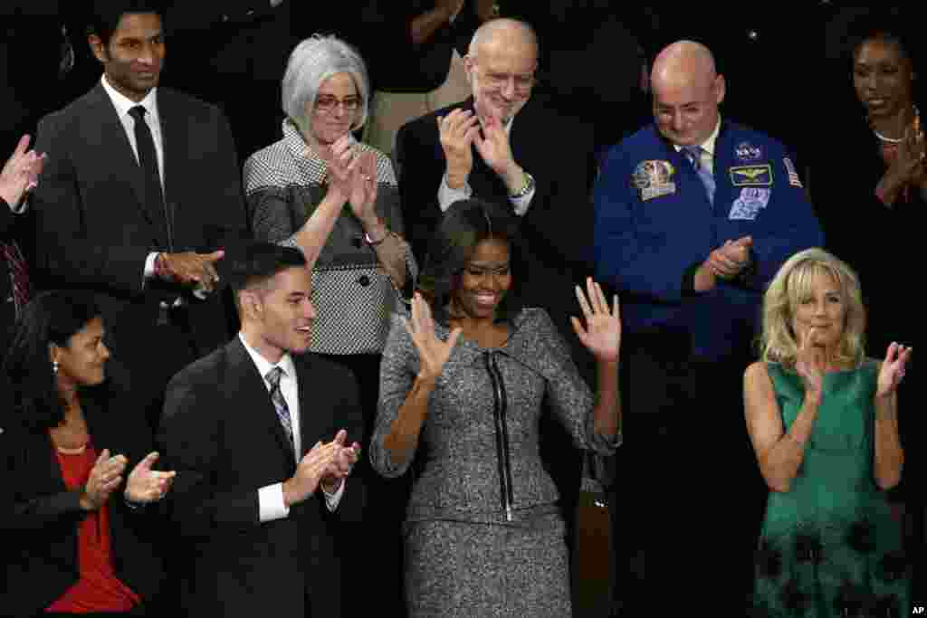 First lady Michelle Obama acknowledges applause before President Barack Obama's State of the Union address on Capitol Hill, Jan. 20, 2015.