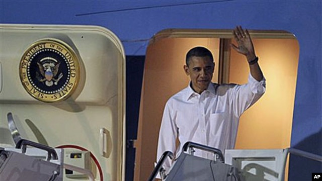 President Barack Obama arrives at Hickam Air Force base in Honolulu, Hawaii, for a holiday vacation, Dec. 23, 2010