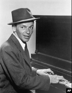 In this 1957 photo, singer Frank Sinatra plays the piano. (File Photo)