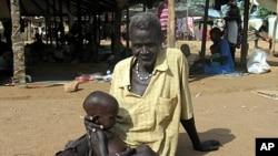 Sudanese man holds malnourished grandson at Medicine Sans Frontieres feeding center, Sept. 2005 (file photo).