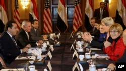 U.S. Secretary of State John Kerry, second from right, meets with members of Egyptian political parties including Ayman Nour, left, in Egypt, March 2, 2013.