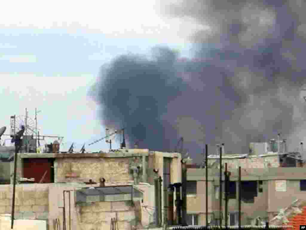 Smoke rises in the city of Homs on January 13, 2012. (Reuters)