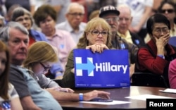Hillary Clinton supporter Shirley Boggs holds a sign during the Democratic presidential candidate caucus at Emporia High School in Emporia, Kansas, March 5, 2016.