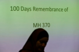 A family member of a Malaysian passenger on board the missing Malaysia Airlines Flight 370 attends the 100 Days Remembrance of MH370 ceremony in Kuala Lumpur, Malaysia, June 15, 2014.