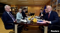 From left, Britain's Secretary of State for Exiting the European Union David Davis, Britain's Prime Minister Theresa May, European Commission President Jean-Claude Juncker and European Union's chief Brexit negotiator Michel Barnier meet at the European Commission in Brussels, Belgium, Dec. 8, 2017.