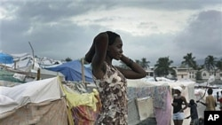 A woman stands next to makeshift tents at a camp set up for earthquake survivors left homeless in Port-au-Prince, one month after a magnitude 7 earthquake struck Haiti, Feb 2010 (file photo)