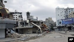 Damage in al-Khaldia neighborhood in Homs is seen during the United Nations' observers visit to the city, May 3, 2012.
