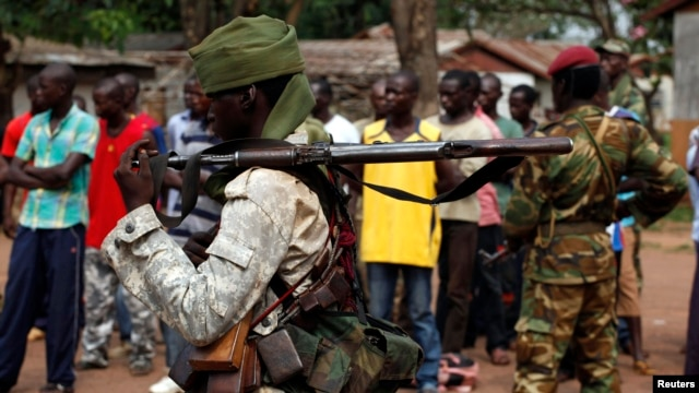 FILE - A Chad soldier holds his weapon in Bangui, Central African Republic, Dec. 9. 2013.