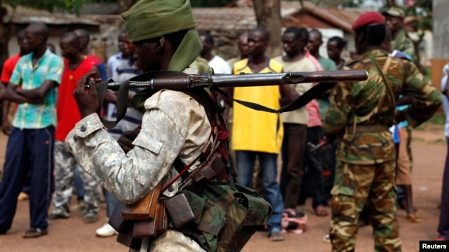 A Chadian soldier holds his weapon in Bangui, Central African Republic, Dec. 9, 2013.