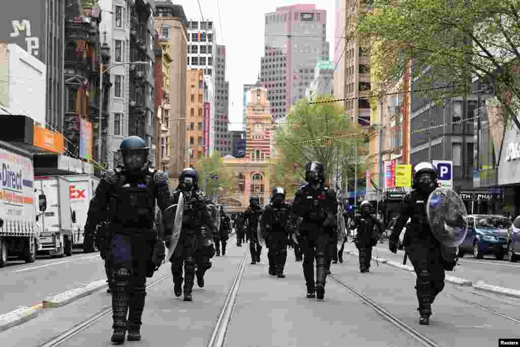 Riot Police respond as protesters rally against the construction industry's COVID-19 mandates, in Melbourne, Australia.