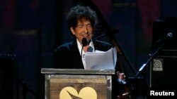 FILE - Musician Bob Dylan speaks at the 2015 MusiCares Person of the Year tribute honoring Bob Dylan in Los Angeles, California, Feb. 6, 2015.