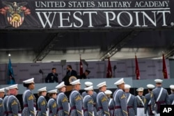United States Military Academy graduating cadets arrive to their graduation ceremony of the U.S. Military Academy class 2021 at Michie Stadium on Saturday, May 22, 2021, in West Point, N.Y. (AP Photo/Eduardo Munoz Alvarez)