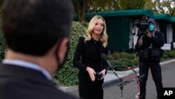 White House press secretary Kayleigh McEnany, talks to the media, Oct. 4, 2020, outside the White House in Washington.