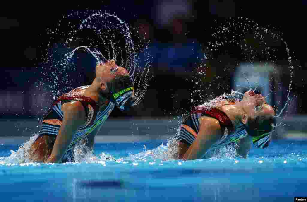 Greece's Evangelia Platanioti and Despoina Solomou perform in the synchronised swimming duet free final during the World Swimming Championships at the Sant Jordi arena in Barcelona, Spain.
