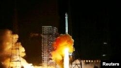 Tên lửa Trường Chinh 3C mang một phi thuyền thử nghiệm được phóng đi từ trung tâm phóng vệ tinh Tây Xương trong tỉnh Tứ Xuyên, 24/10/14
