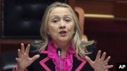 Secretary of State Hillary Rodham Clinton makes a speech at the Parliament in the capital Tirana, Albania.