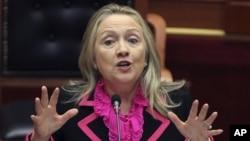 Secretary of State Hillary Rodham Clinton makes a speech at the Parliament in the capital Tirana, Albania.