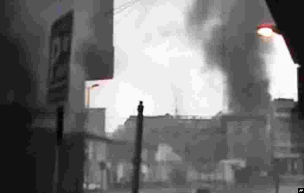 This image made from amateur video purports to show black smoke rising from buildings in Homs, Syria, March 29, 2012. (AP)
