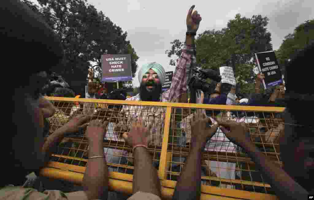 Indian Sikhs protest in New Delhi against Sunday's shooting in the U.S. Indian Prime Minister Manmohan Singh said Monday that he was shocked and saddened by the attack.