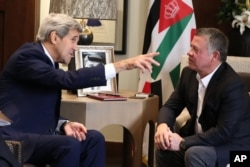 Jordanian King Abdullah II, right, meets with U.S. Secretary of State John Kerry at the Royal Palace in Amman, Jordan, Oct. 24 2015.