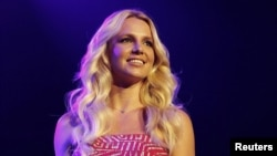 Britney Spears smiles on stage at the 2011 Wango Tango concert in Los Angeles, May 14, 2011