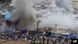 FILE - Kenya post-election rioting can be seen in this Dec. 31, 2007, photo. Some say next year's election could reignite rivalries, if Deputy President William Ruto decides to run against incumbent Uhuru Kenyatta.