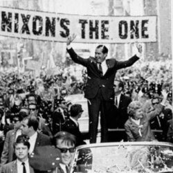 """A huge banner reading """"Nixon's the one"""" is stretched across Chestnut Street in Philadelphia in September, 1968, during the reception for the Republican presidential candidate. Pat Nixon rode in the car with her husband"""
