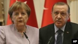 From left, German Chancellor Angela Merkel and Turkish President Recep Tayyip Erdogan.