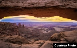 Mesa Arch overlooks Canyonlands National Park in Utah. (Photo by David Fortney, Courtesy of MacGillivray Freeman Films)