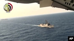 In this video image released by the Egyptian Defense Ministry, an Egyptian plane flies over an Egyptian ship during the search in the Mediterranean Sea for the missing EgyptAir flight 804, May 19, 2016.