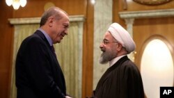 Turkey's President Recep Tayyip Erdogan, left, and Iran's President Hassan Rouhani greet each other before a meeting with Russia's President Vladimir Putin, in Sochi, Russia. Turkey and Iran recently signed an agreement with Qatar to ease some trade.
