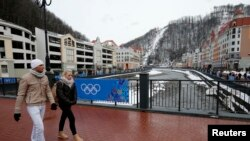 People walk at the Rosa Khutor Alpine Resort in Krasnaya Polyana near Sochi, Jan. 26, 2014.
