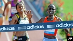 FILE - Runners are seen at the ADIDAS Grand Prix at Icahn Stadium on Randalls Island in New York, June 12, 2010.