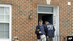FBI Investigators leave the home of Farooque Ahmed in Ashburn, Va. Ahmed, a naturalized citizen born in Pakistan was arrested Wednesday and charged with trying to help people posing as al-Qaida operatives planning to bomb subway stations around the nation