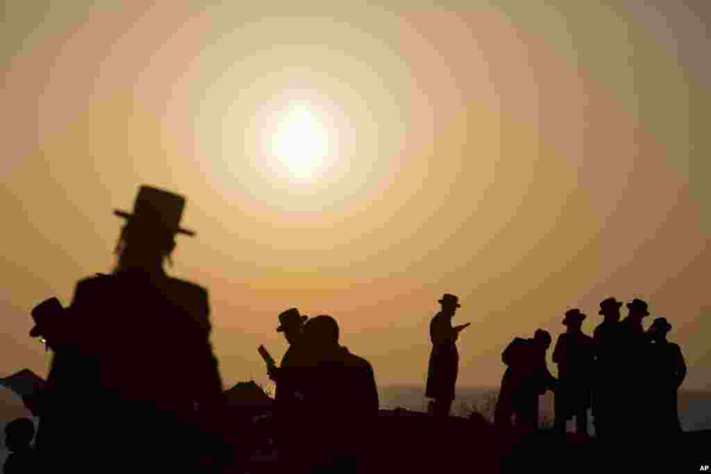 "Ultra-Orthodox Jews of the Hassidic sect Vizhnitz pray on a hill overlooking the Mediterranean Sea as they participate in a Tashlich ceremony in Herzeliya, Israel. Tashlich, which means ""to cast away"" in Hebrew, is a practice in which Jews go to a large flowing body of water and symbolically ""throw away"" their sins by throwing a piece of bread, or similar food, into the water before the Jewish holiday of Yom Kippur, which starts on Tuesday at sundown."