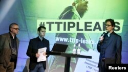 Juergen Knirsch (L-R), Volker Gassner and Stefan Krug of the environmental campaign group Greenpeace address a news conference as they present a copy of the leaked TTIP negotiations in Berlin, Germany, May 2, 2016.