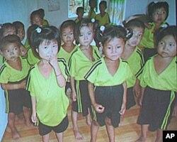 齐麦可所摄北韩饥民儿童,十岁看起来只有五岁
