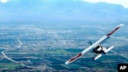 FILE - A Cessna 182 tows a glider plane.