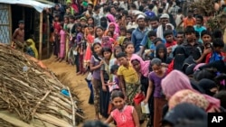 Rohingya Muslims, who from Myanmar into Bangladesh, wait in queues to receive aid at Kutupalong refugee camp in Ukhiya, Bangladesh, Nov. 15, 2017. Secretary of State Rex Tillerson called for an independent investigation into a humanitarian crisis in which