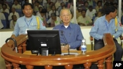 Ieng Sary, center, former Khmer Rouge's foreign affair minister, sits in a court dock of the U.N.-backed genocide tribunal, during a hearing, file photo.