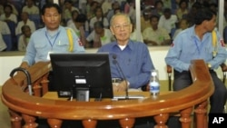 Ieng Sary, center, former Khmer Rouge's foreign affair minister, sits in a court dock of the U.N.-backed genocide tribunal, during a hearing Friday, April 30, 2010, in Phnom Penh.