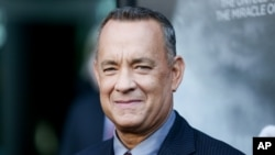 Tom Hanks bumped into a couple taking wedding photos in New York City.