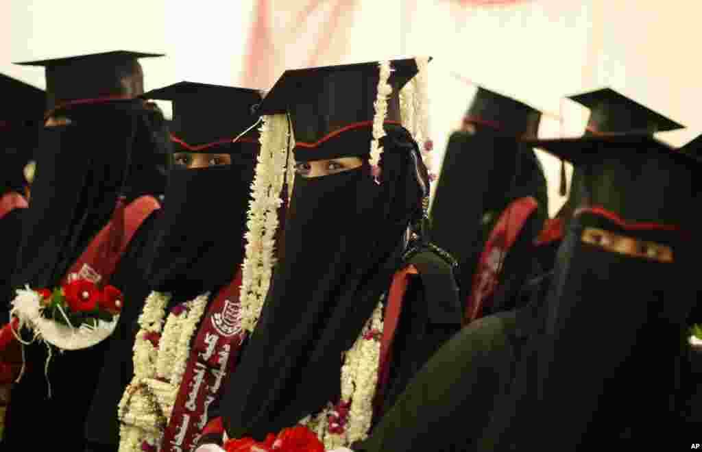 Yemeni female university students celebrate during their graduation ceremony in Sana'a, April 28, 2014.