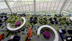 Students work in the Rain Garden Reading Lounge inside the Hunt Library at North Carolina State University in Raleigh, N.C., May 3, 2016.