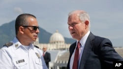 U.S. Attorney General Jeff Sessions speaks with Howard Augusto Cotto Castaneda, Director General of the National Police as they look over the city from the roof during a visit to the National Police Headquarters in San Salvador, El Salvador, July 28, 2017.