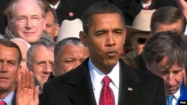 President Obama taking the oath of office at his first inauguration in 2009.