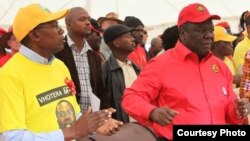 Former Prime Minister and MDC-T leader Morgan Tsvangirai and Mavambo Kusile Dawn party leader Simba Makoni addressing people at Sakubva Stadium, Mutare, Manicaland Province, in the run up to the 2013 general election.