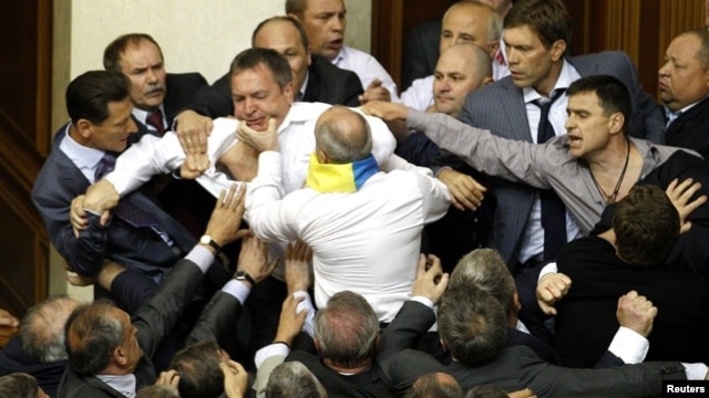 Deputies scuffle during a session in the chamber of the Ukrainian parliament in Kiev, May 24, 2012.